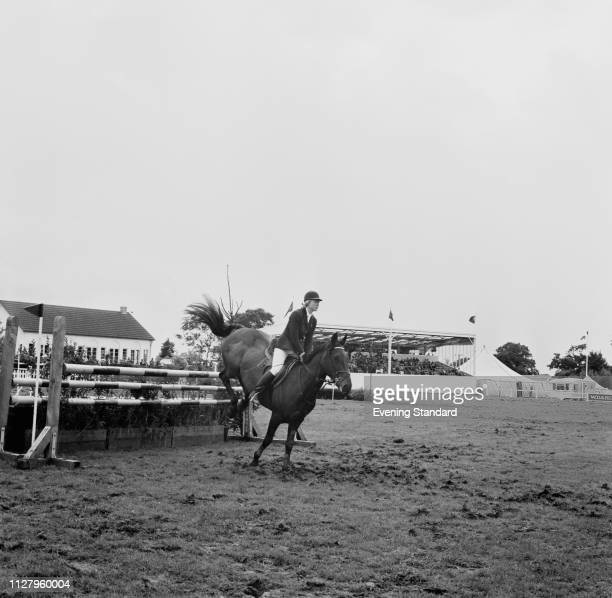 English showjumper Marion Coakes in action at a show jumping event UK 5th September 1968