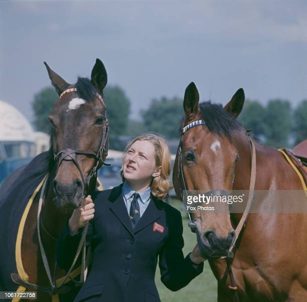 English showjumper Marion Coakes with her horses Stroller and Little Fellow at the Royal Windsor Horse Show Berkshire UK 1966