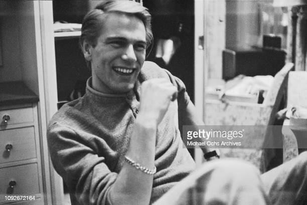 English singer Adam Faith in a hotel room during a visit to New York circa 1968