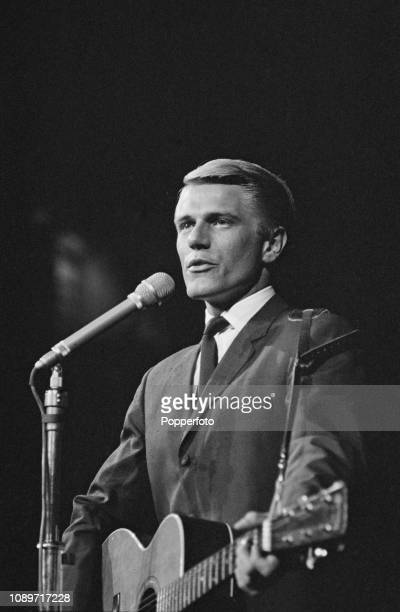 English singer Adam Faith performs live on stage during the Popperfoto via Getty Images Beat Festival at the Royal Albert Hall in London in April 1961