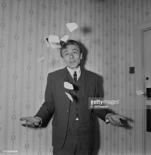 English singer Adam Faith pictured throwing torn up paper in the air on 23rd December 1964 Adam Faith has just announced he has cancelled his...