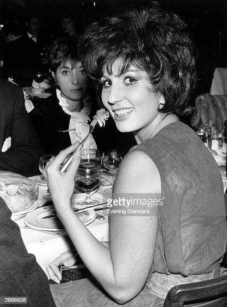 English singer Alma Cogan enjoying a meal at the Pigalle nightclub London