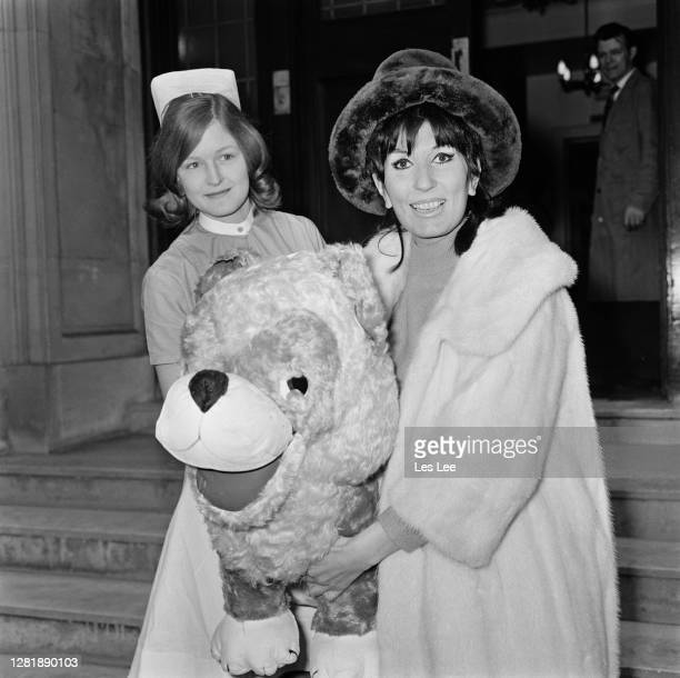 English singer Alma Cogan leaves hospital after an operation UK 5th March 1966 She died later that year of cancer