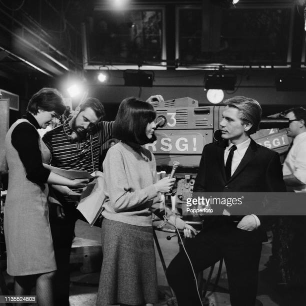 English singer and actor Adam Faith is interviewed by host Cathy McGowan on the set of the music television show Ready Steady Go at the Rediffusion...