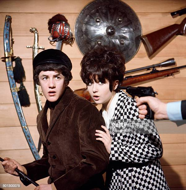 English singer and actor Adrienne Posta pictured with actor Kenneth Nash in a scene from the television drama 'Action' in 1966