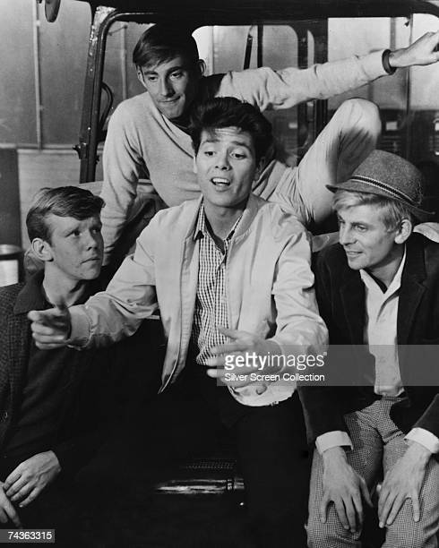 English singer and actor Cliff Richard as Don in 'Summer Holiday' directed by Peter Yates 1963 On the right is English comic actor Melvyn Hayes as...