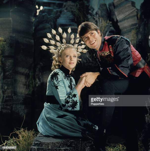 English singer and actor Cliff Richard pictured with actress Vanessa Howard in a scene from the television adaptation of the pantomime 'Aladdin' in...