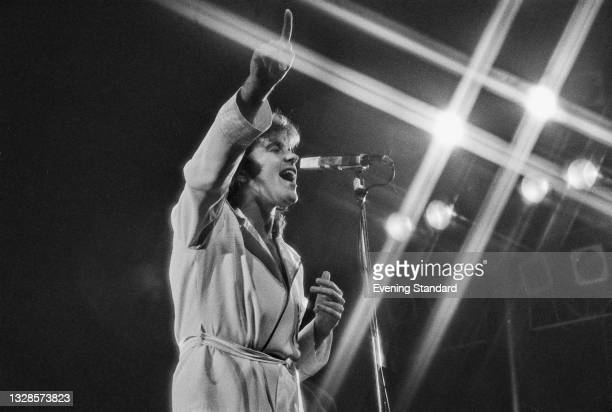 English singer and actor David Essex performs live at the New Victoria Theatre in London, UK, December 1974.