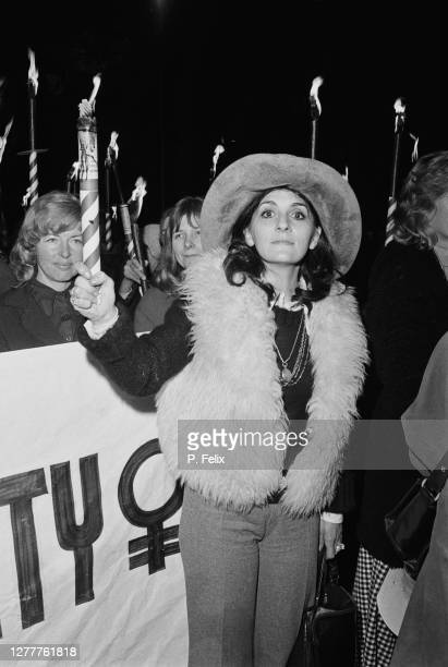 English singer and actress Georgia Brown leads a torchlight march on Downing Street in London UK to demand equality for women 2nd February 1973 The...