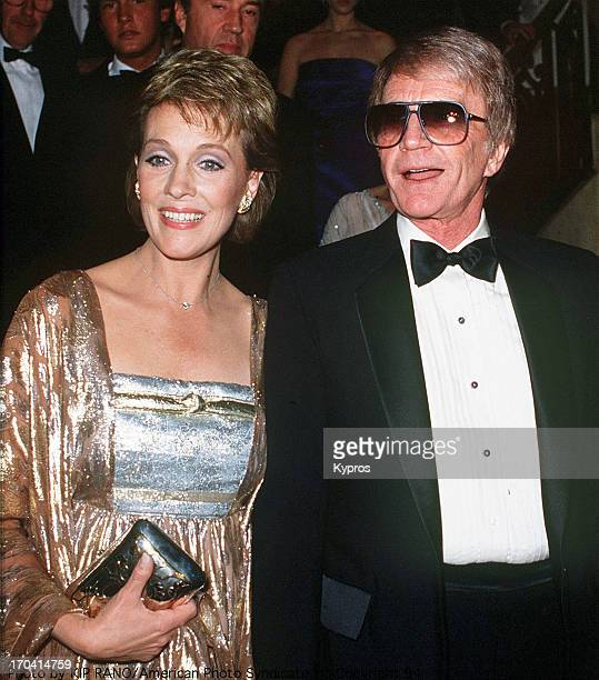 English singer and actress Julie Andrews with her husband Blake Edwards at a British Olympic Association gala, 18th April 1984.