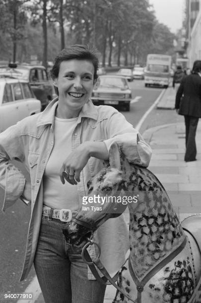 English singer and actress Julie Covington poses with a rocking horse outside the Dorchester Hotel in London 9th June 1977 She appears on the 1977...