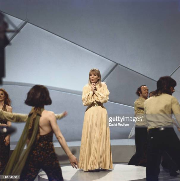 English singer and actress Petula Clark performs with male and female dancers on a BBC television show at Television Centre in London in 1972.