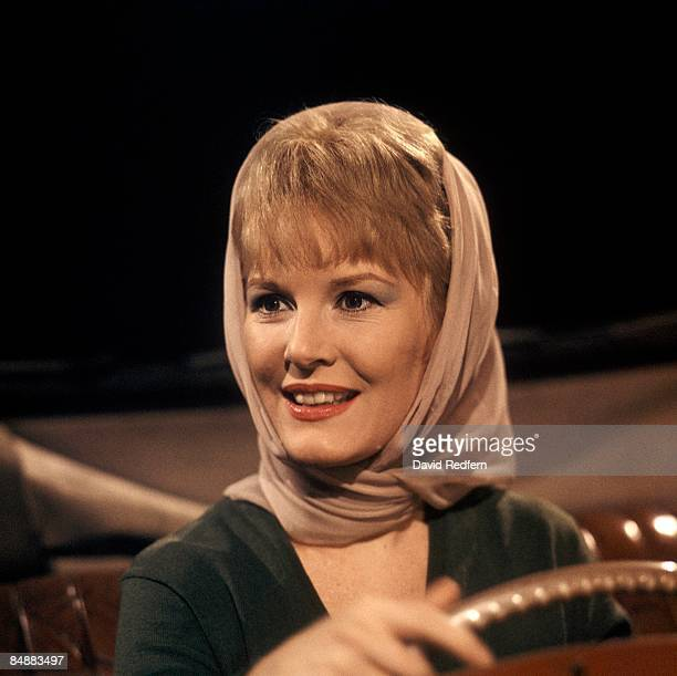 English singer and actress Petula Clark seated in the driver's seat of a car on a television show in London circa 1963.