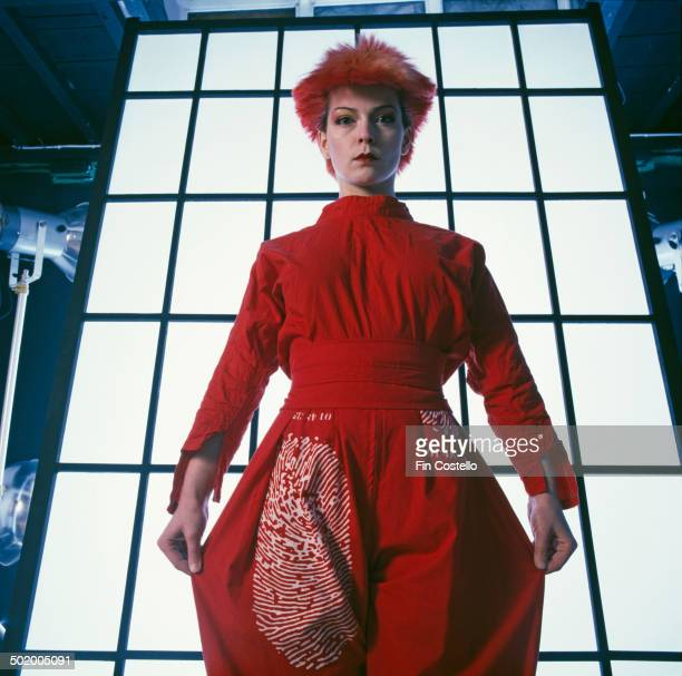 English singer and actress Toyah Willcox wearing a red trouser suit with a fingerprint motif 1980