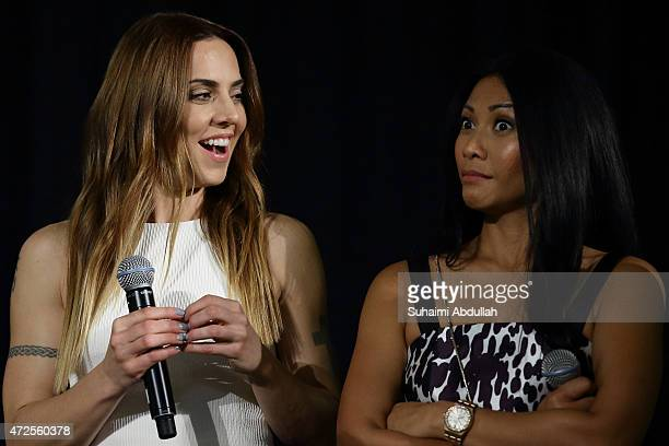 English singer and former Spice Girl Melanie Chisholm and Indonesianborn French singer and songwriter Anggun Cipta Sasmi share a moment on stage...