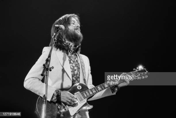 English singer and guitarist Eric Clapton appears in Eric Clapton's Rainbow Concert at the Rainbow Theatre, London, 13th January 1973. He is playing...