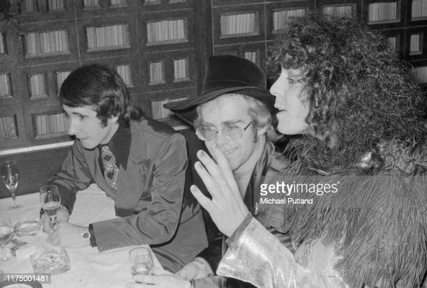 English singer and guitarist Marc Bolan on right with singer and pianist Elton John and his manager John Reid at the UK premiere of the T Rex concert...