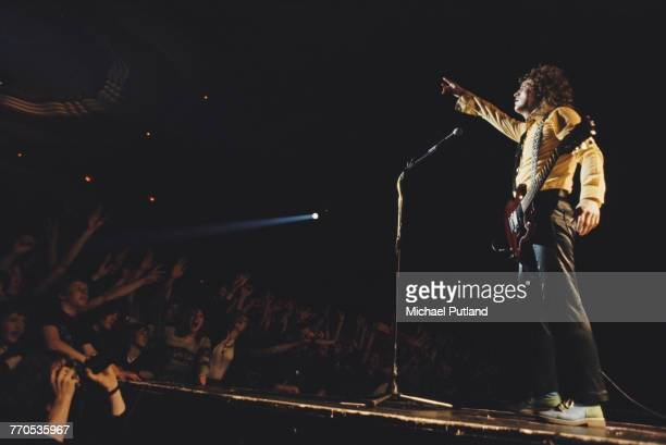 English singer and guitarist Noddy Holder of British rock group Slade performs live on stage in front of fans at a concert in England in 1981