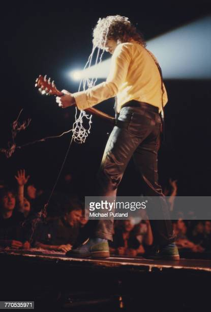 English singer and guitarist Noddy Holder of British rock group Slade performs live on stage in front of fans during a concert in England in 1981