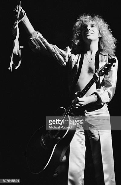 English singer and guitarist Peter Frampton holding up a bra thrown on stage by a fan during a concert at Madison Square Garden New York 23rd August...