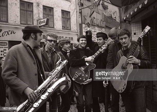 English singer and guitarist Tony Sheridan posed far right with his band outside the Star Club in Hamburg Germany circa 1965