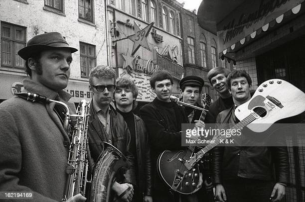 Circa 1965: English singer and guitarist Tony Sheridan posed far right with his band outside the Star Club in Hamburg, Germany circa 1965.