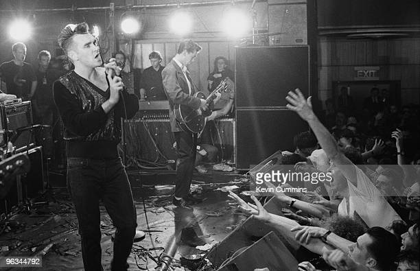 English singer and lyricist Morrissey performing at his first solo concert after the break-up of The Smiths, at Wolverhampton Civic Hall, 22nd...