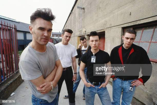 English singer and lyricist Morrissey with his band during the 'Kill Uncle' tour 1991 Left to right Morrissey guitarist Alain Whyte guitarist Boz...