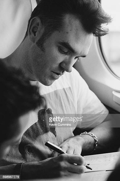 English singer and lyricist Morrissey writing during a train journey in Japan during his Kill Uncle Tour August September 1991