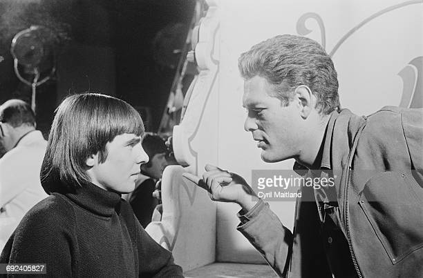 English singer and musician Davy Jones of the Monkees with televisoin producer Bert Schneider 19th December 1966