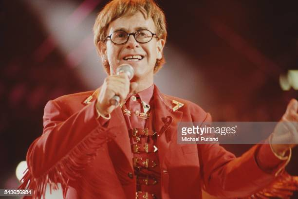 English singer and musician Elton John performing on stage during the Freddie Mercury Tribute Concert for Aids Awareness at Wembley Stadium in London...
