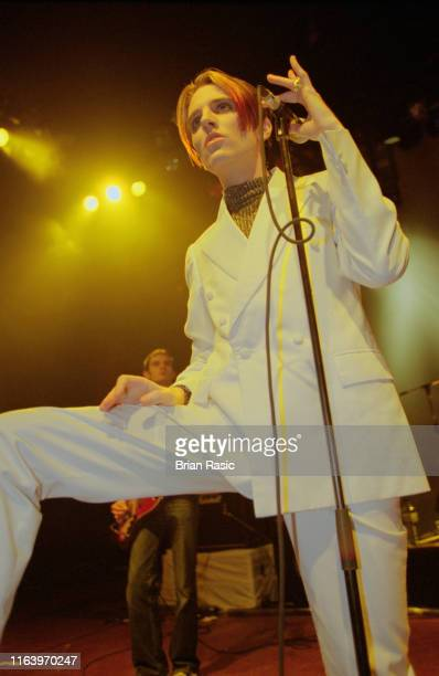 English singer and musician Johnny Dean of Britpop group Menswear performs live on stage at Shepherd's Bush Empire in London during the band's...
