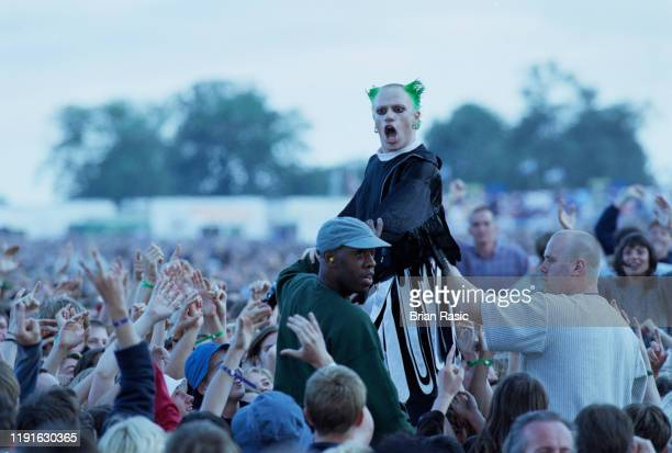 English singer and musician Keith Flint of The Prodigy leaves the stage to crowd surf over the audience during the group's support slot for rock...