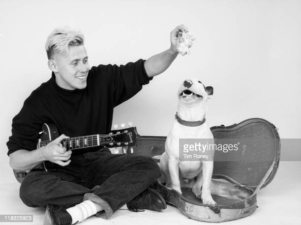 English singer and musician Kirk Brandon with his pet Bull Terrier, circa 1982. He was a member of groups The Pack, Theatre of Hate and Spear of...