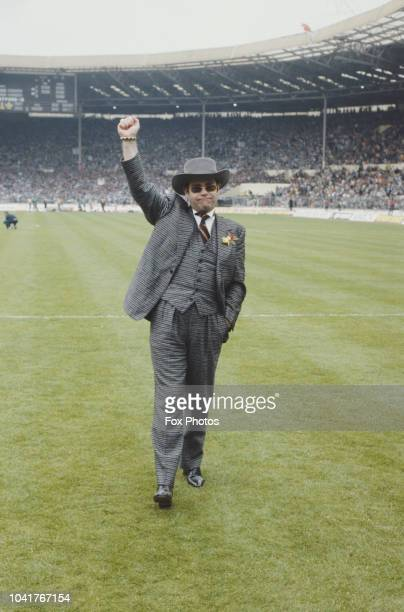 English singer and pianist Elton John chairman of Watford Football Club at Wembley Stadium in London during the FA Cup Final 19th May 1984 Everton...