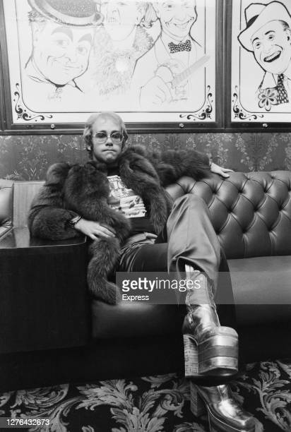 English singer and pianist Elton John poses in the bar of the London Palladium, during rehearsals for the Royal Variety Performance, UK, October 1972.