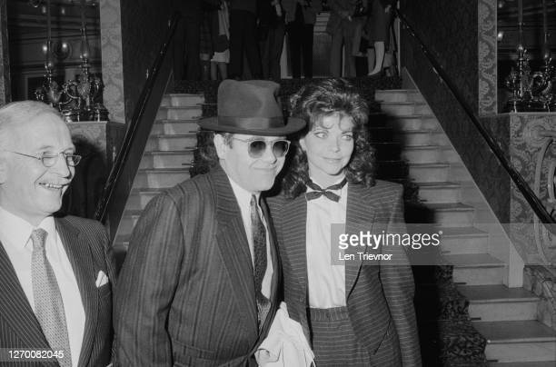 English singer and pianist Elton John with his wife Renate Blauel at the theatre, London, UK, 17th February 1985.