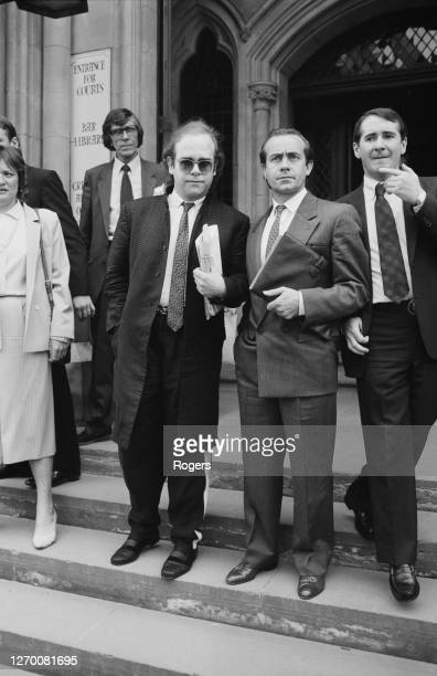 English singer and pianist Elton John with lyricist Bernie Taupin at the High Court in London, UK, 4th June 1985. They are suing their former manager...