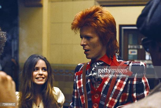 English singer and songwriter David Bowie at Union Station Los Angeles with model Patty Clark of Star magazine California March 1973