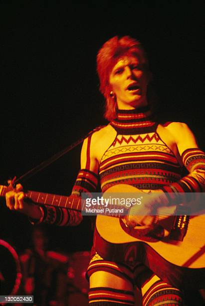 English singer and songwriter David Bowie performing in a knitted body suit on the Ziggy Stardust Tour 1973