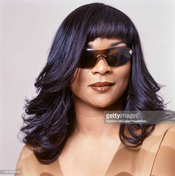 English singer and songwriter Gabrielle posed wearing sunglasses on 12th October 2001