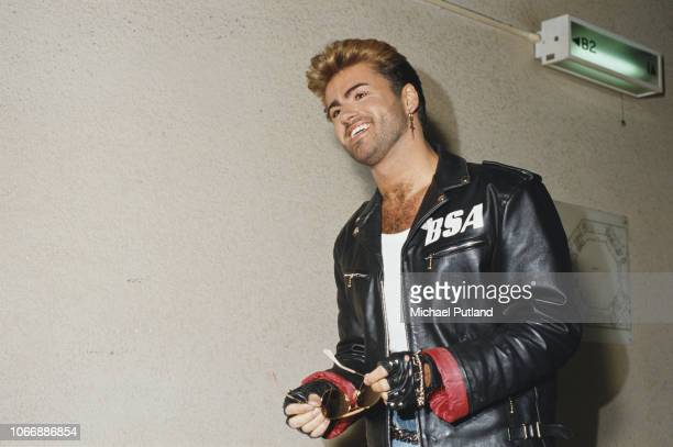 English singer and songwriter George Michael pictured wearing a leather jacket with BSA logo backstage during the Japanese/Australasian leg of his...