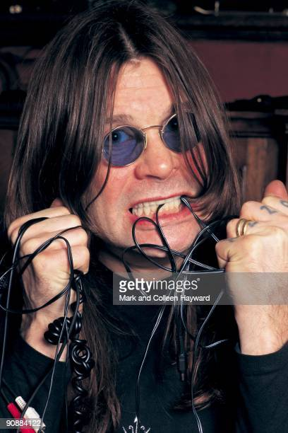 English singer and songwriter Ozzy Osbourne becomes entangled in the wires whilst trying to connect up his record and CD decks 1990