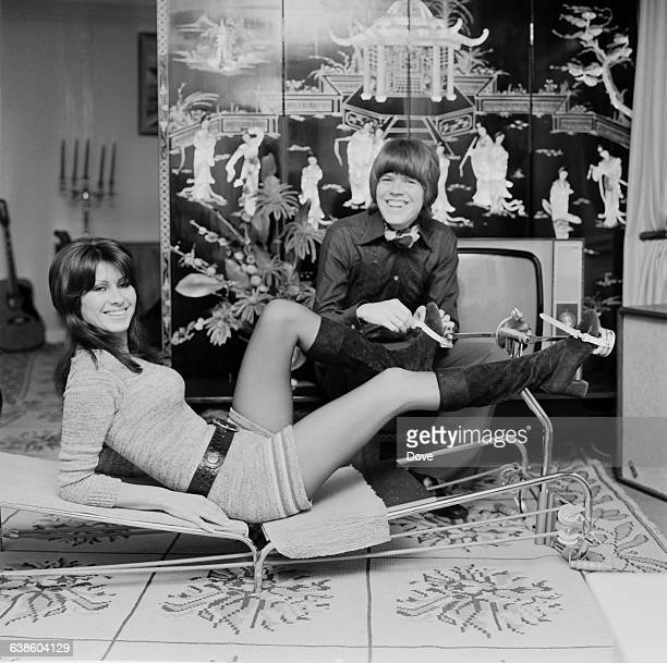 English singer and songwriter Peter Noone and his wife Mireille Noone testing a keepfit machine UK 7th May 1971
