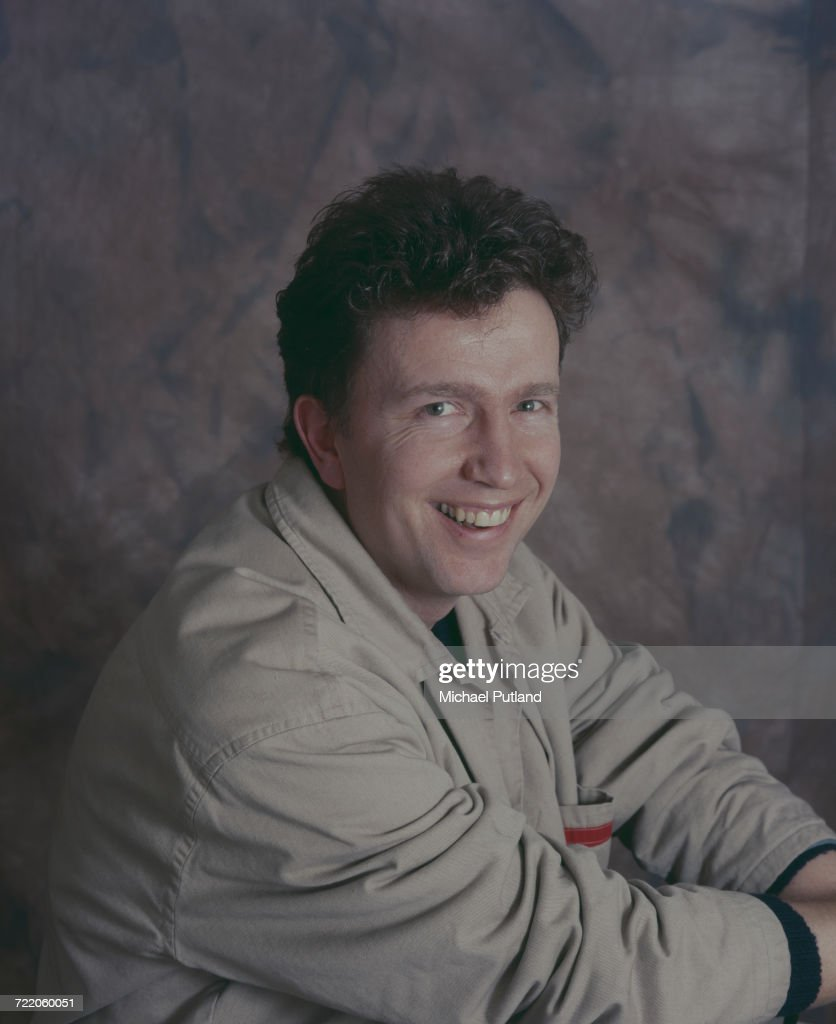English singer and songwriter Tom Robinson posed in a studio in 1987. Tom Robinson was singer and bass player in the Tom Robinson Band.
