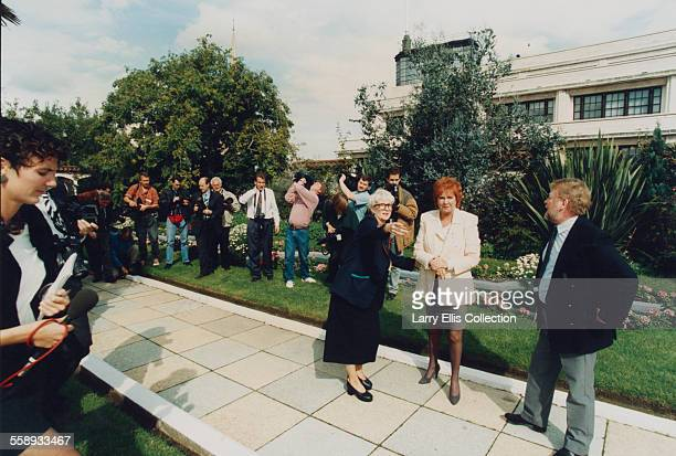English singer and television personality Cilla Black with her husband Bobby Willis at the Kensington Roof Gardens London 1993