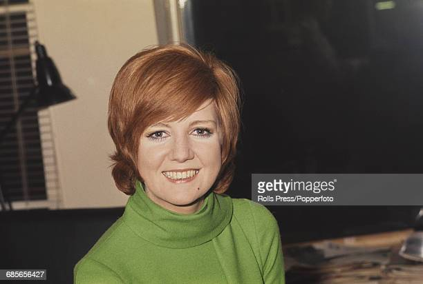 English singer and television presenter Cilla Black posed wearing a lime green sweater with cowl style neck in London in December 1968