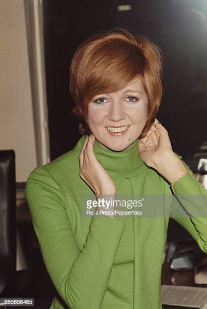 English singer and television presenter Cilla Black posed wearing a lime green sweater with cowl neck in London in December 1968