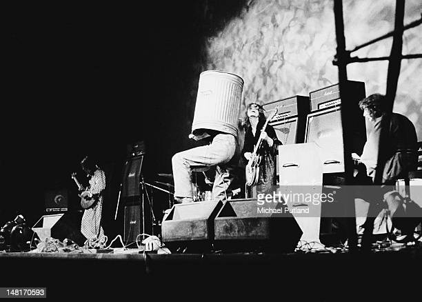 English singer Arthur Brown wearing a dustbin on his head during a performance with Kingdom Come at the Rainbow Theatre London 7th November 1971 Left...