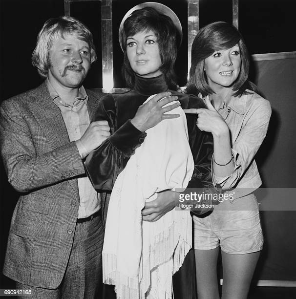 English singer Cilla Black and her husband Bobby Willis admire the waxwork of Cilla with their baby son Robert at Madame Tussauds in London 31st July...